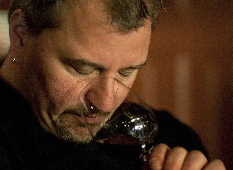 Smith takes in the aroma of a red during a wine tasting at The Grill Room.