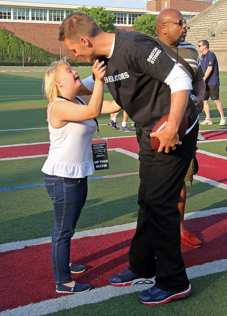 "New England's Tom Brady greets ""Glee"" cast member Lauren Potter at the Best Buddies charity football game at Harvard on Friday. Patriot Danny Amendola also helped the fundraiser."