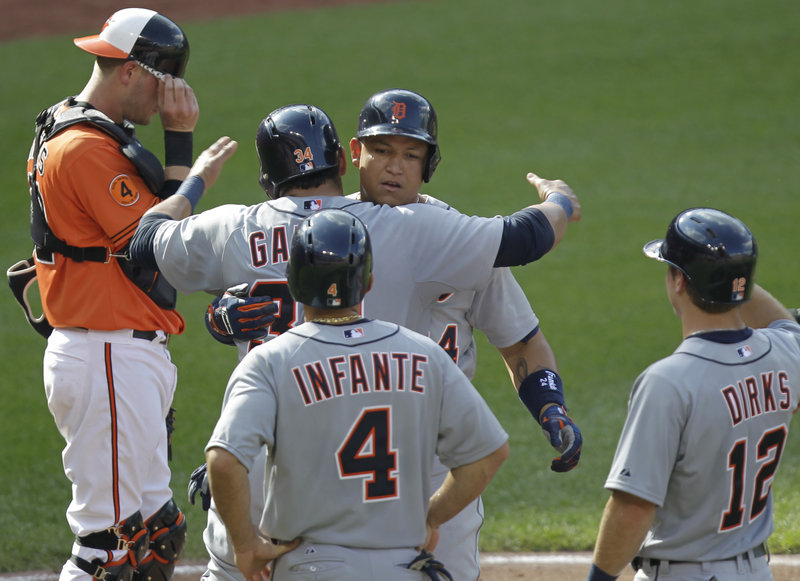Miguel Cabrera of the Tigers celebrates with teammates after hitting a grand slam – one of four fourth-inning home runs for Detroit in a 10-3 win over the Orioles.