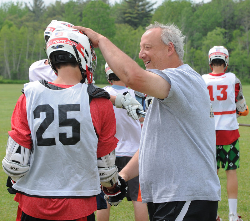 """Coach Tom Fiorini, seen with Brett Soucy at practice, said, """"We go out and do our jobs. They learned that from Ted ... an even-keel kind of coach."""""""