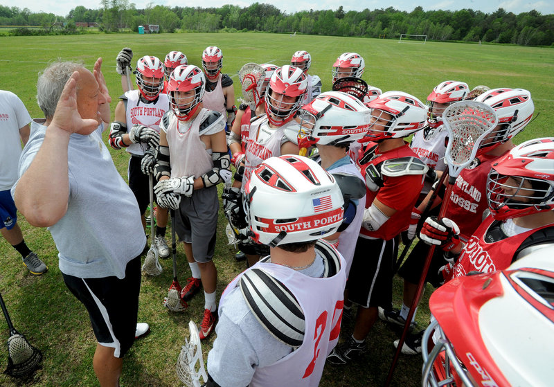 South Portland Coach Tom Fiorini talks to his team at practice on Monday, as the Riots prepare for Tuesday's playoff game against Gorham – a team the Riots beat in a 12-7 game back on April 17.