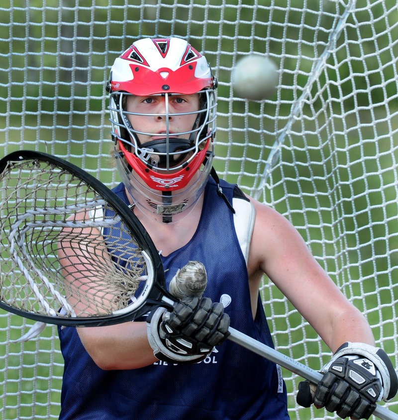 """T-Moe Hellier, a sophomore goalie, is the son of longtime youth coach Ted Hellier. """"Coach Ted has been such a big part of all of our lives for such a long time,"""" said junior midfielder Duncan Preston."""