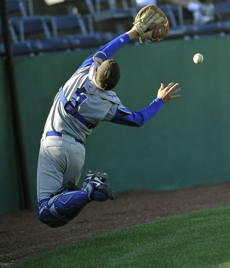 OOB catcher Tim Ellison twists and turns to try to make a circus catch of a foul ball, but comes up short.