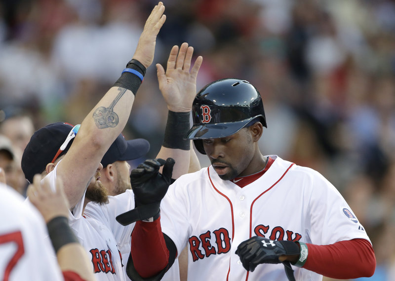 Jackie Bradley Jr. showed a flash of his torrid spring training offense, belting his first major league home run in a 17-5 rout of Texas on Tuesday.