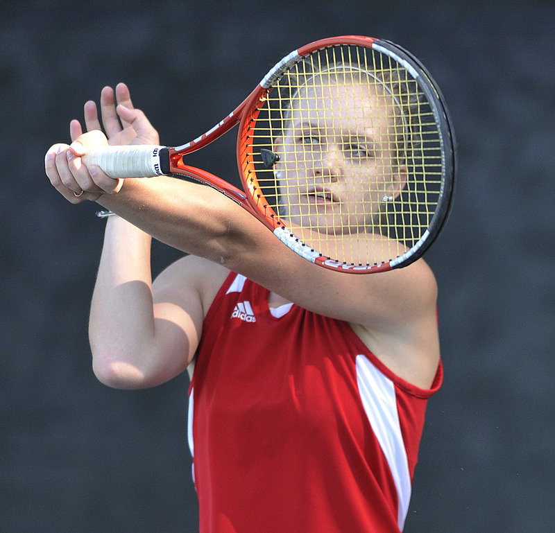 Mikaela Gove of Scarborough hits a return Wednesday during her loss to Portland's Sophie Hulbert at No. 2 singles in the Western Class A final. Portland won, 4-1.