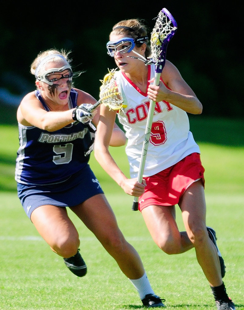 Josie Lee of Cony drives to the net against Portland's Hallie Alex. Lee scored twice in the Rams' 12-8 win.