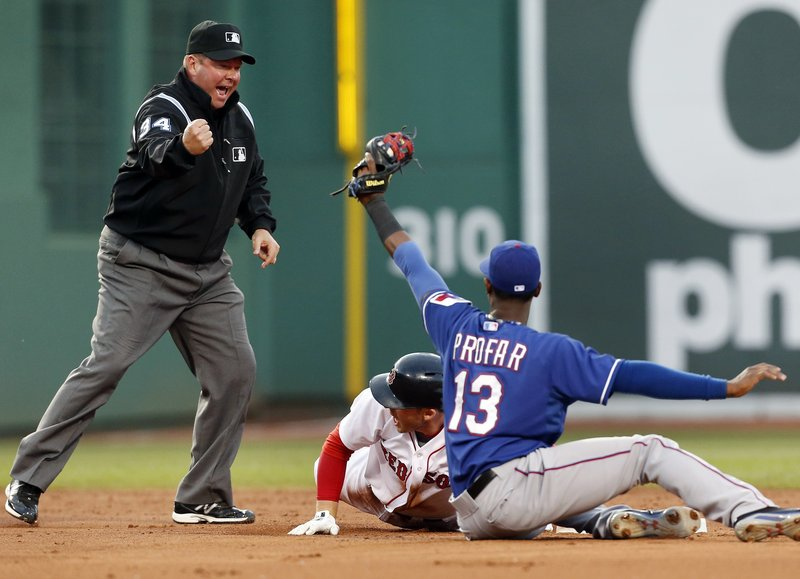 Umpire Sam Holbrook makes the emphatic out call on Boston's Stephen Drew as Texas' Jurickson Profar displays the ball in the Rangers' 3-2 win at Boston on Wednesday.