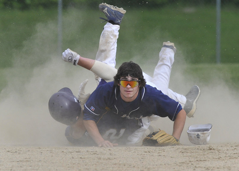 Westbrook shortstop Collin Joyce watches his throw to first, completing a double play Thursday after forcing Liam Fitzpatrick of Cheverus in the third inning. Westbrook rallied at home for a 3-2 win in a Western Class A quarterfinal.
