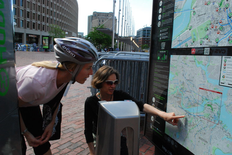 Eileen Morrison of Boston learns the nearest Boston Bike Share hub to her home from Nicole Freedman, Boston Bike's director, during rush hour.