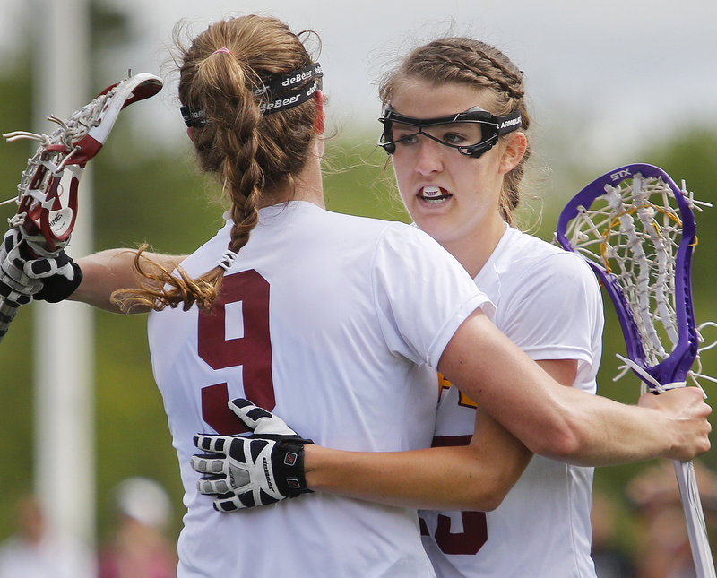 Talley Perkins, right, celebrates with teammate Lauren Steidl after scoring one of her three goals Saturday for Cape Elizabeth in a 17-10 girls' lacrosse victory. The Capers will play top-seeded Waynflete for the regional title Wednesday.