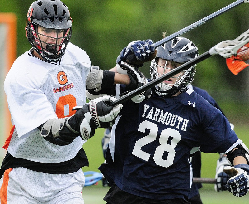Gardiner's Josh Moore, left, tries to get around Yarmouth's Isaak Dearden in Wednesday's Eastern Class B boys' lacrosse championship game at Thomas College in Waterville. Yarmouth won, 15-3.