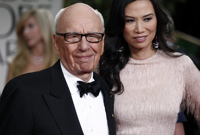 Rupert Murdoch and his wife, Wendi, arrive at the 69th Annual Golden Globe Awards in Los Angeles in 2012.