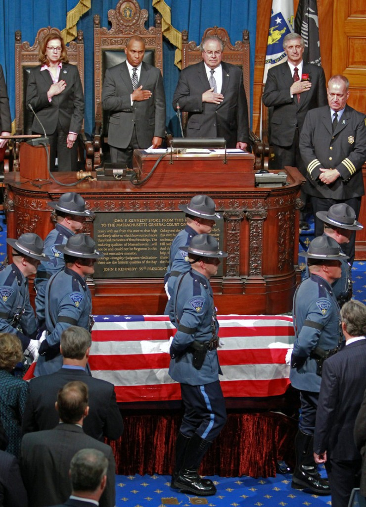 Pallbearers bring in Cellucci's casket for the memorial service Thursday in Boston.