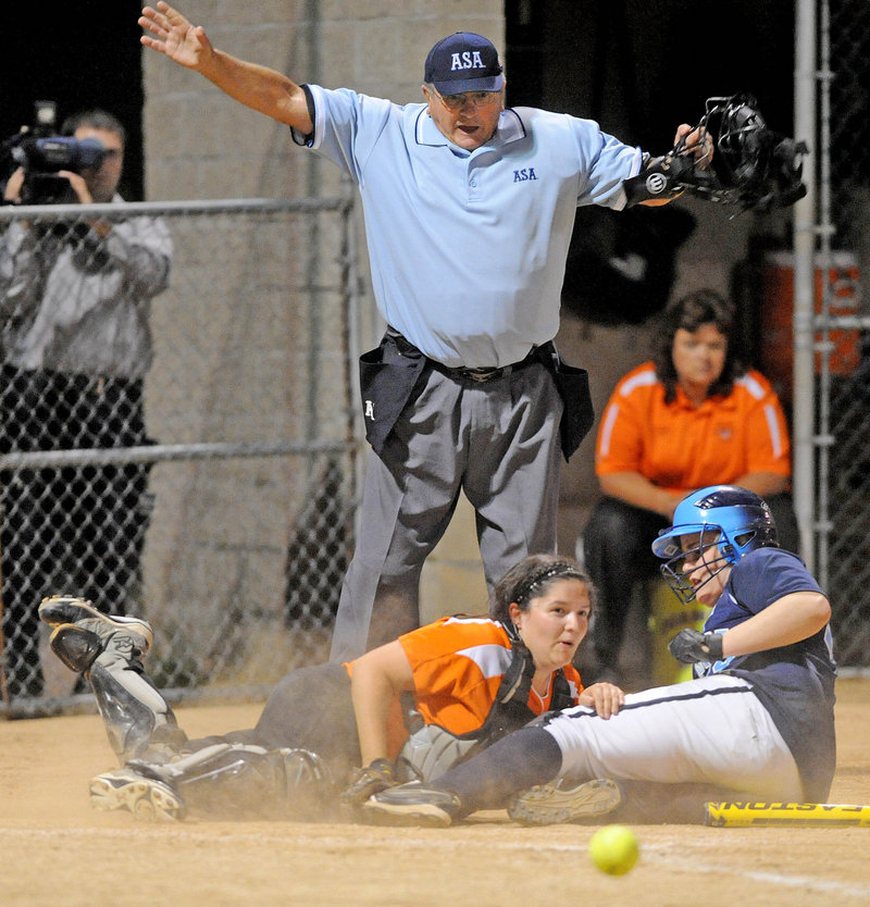 Kennadi Grover of Oceanside slides across the plate Thursday night as the ball gets away from Gardiner catcher Stephanie Plourd in the sixth inning of Oceanside's 11-4 victory in the Eastern Class B softball final.