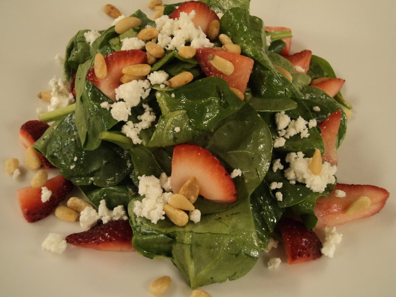 At Sea Glass in Cape Elizabeth, chef Mitchell Kaldrovich will be serving a strawberry and spinach salad made with baby spinach, goat cheese, pine nuts, fresh strawberries and a honey-sherry vinaigrette.