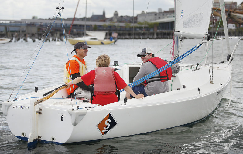 Volunteer skipper Jamie Carlson of Peaks Island takes a couple of visitors around Portland Harbor from Sail Maine's base off the Eastern Promenade. Certified sailors can also rent the boats for $80 for a few hours of fun.