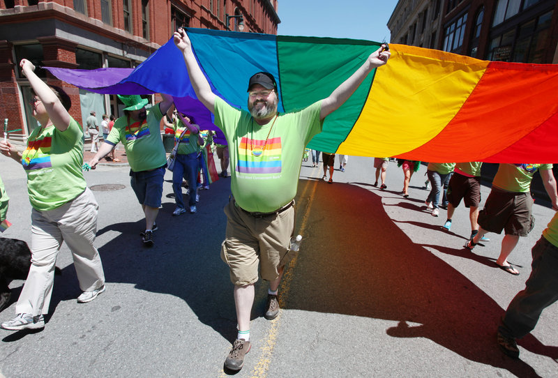 Dan Plourd of Portland helps carry a flag during the annual Pride Parade in Portland. Saturday's event was the 27th annual Southern Maine Gay Pride Parade and Festival.