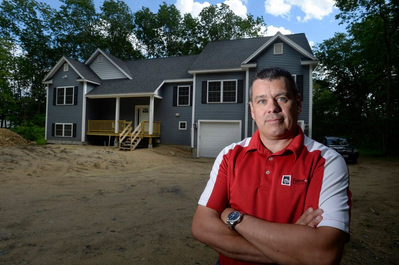 Larry Duell of Father and Son Builders, Inc. in front of a home the company recently built on Captain Thomas Road in Ogunquit on Monday, June 17, 2013. For the first time in seven years, most U.S. homebuilders are optimistic about home sales.