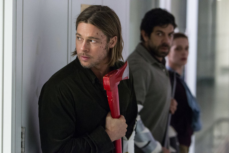 "Brad Pitt, top, and with Daniella Kertesz, above, in scenes from ""World War Z."""