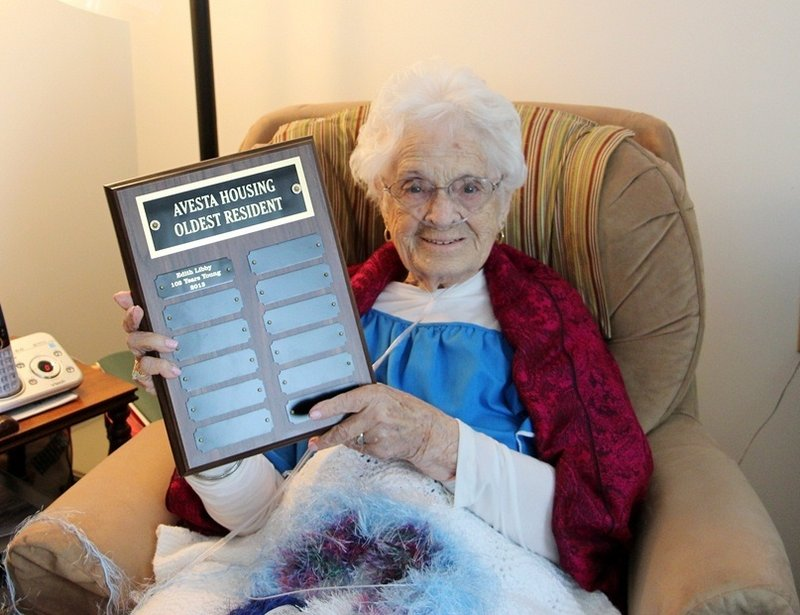 Edith Libby holds a plaque presented to her in March as the oldest resident in all of Avesta's 68 properties. Mrs. Libby died Saturday at age 102 after a brief illness.