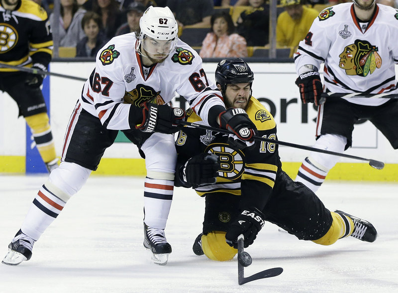 Paying the price is a huge part of playoff hockey. Nathan Horton of the Bruins knows that well as he goes to his knees to thwart Blackhawks center Michael Frolik in the second period Monday night in Boston.