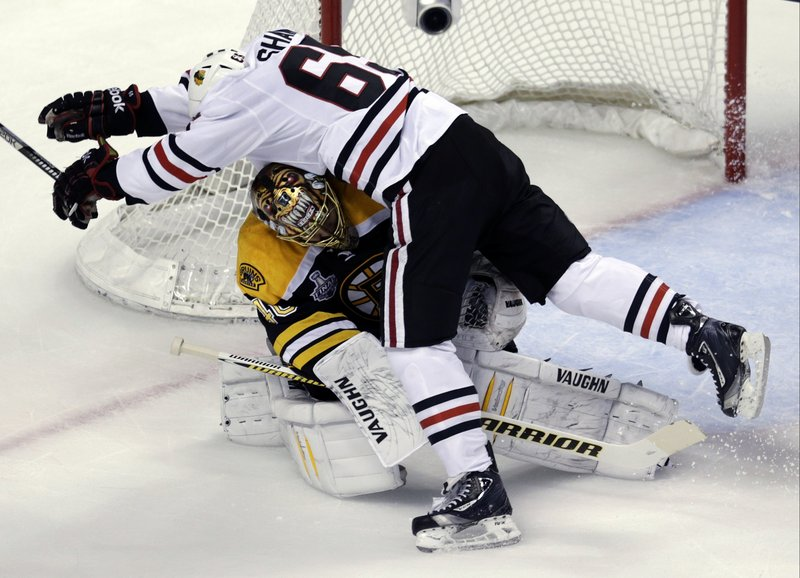 Bruins goalie Tuukka Rask gets slammed into by Chicago's Andrew Shaw in the first period Monday night. No big deal. Rask made 28 saves as the Bruins took a 2-1 series lead in the Stanley Cup finals with a 2-0 win at Boston.