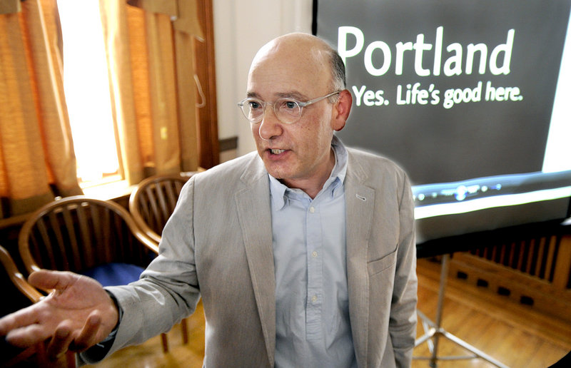 Business owner David Puelle of Puelle Design joined other business leaders Tuesday, June 18, 2013 as the city of Portland unveiled its new slogan promote the city: