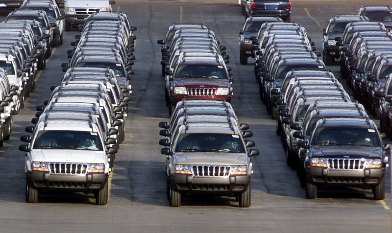Chrysler has agreed to recall 2.7 million older-model Grand Cherokees, like these outside a plant in Detroit, and Libertys to fix fuel tanks that could cause fires in rear-end crashes.