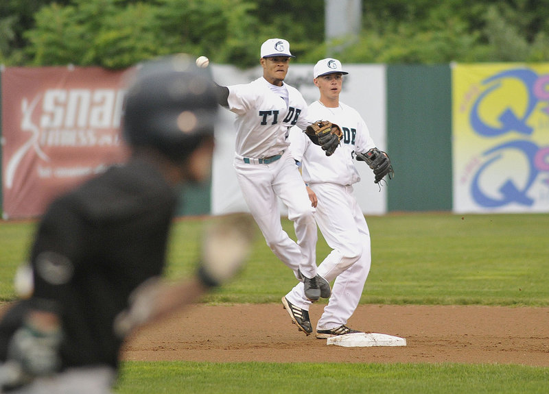 Second baseman Aaron Wilson of the Old Orchard Beach Raging Tide throws to first to complete a double play in the first inning Tuesday night in a 7-6 victory against the Pittsfield Suns at The Ballpark.