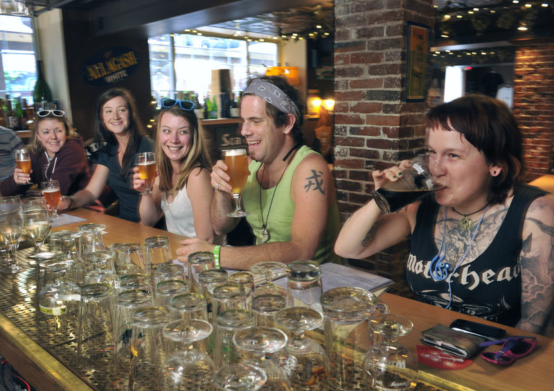 Customers – from left, Sarah Jump, Biz Wing, Erika Colby, Brian Gallant and Helen Walden – enjoy the selections at Novare Res Bier Cafe in Portland on Wednesday. A swarm of beer lovers is expected to visit the city this weekend.