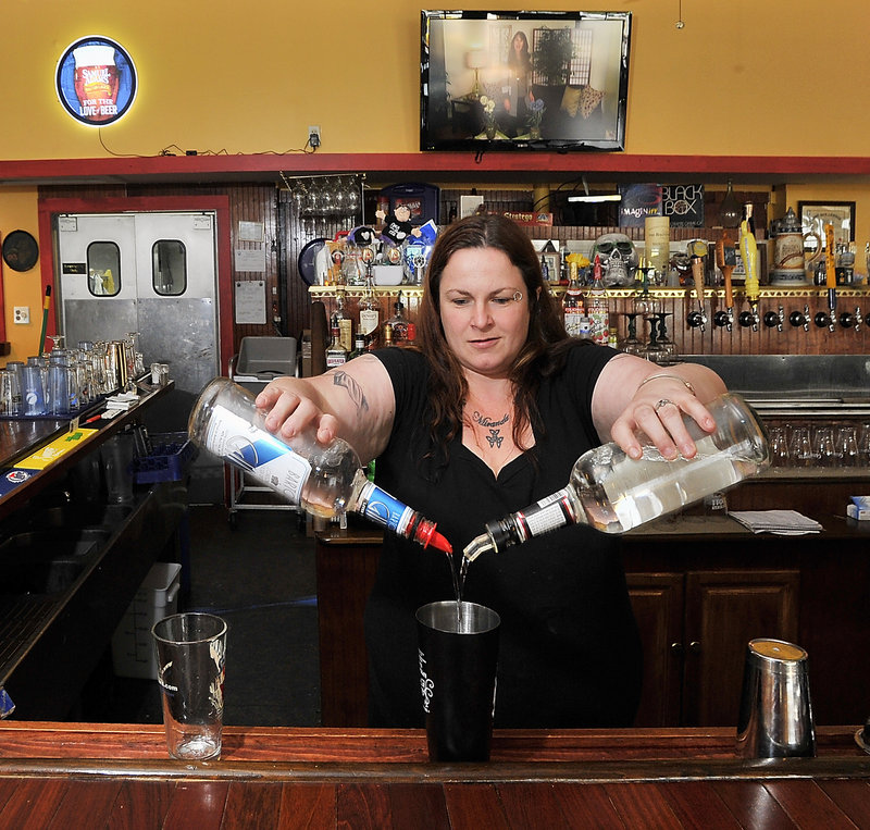 Kelly Greenlaw makes a Kinky Kilt at the GFB Scottish Pub in Old Orchard Beach by blending vodka, tequila, rum, gin, Triple Sec, melon liquor and Sprite.