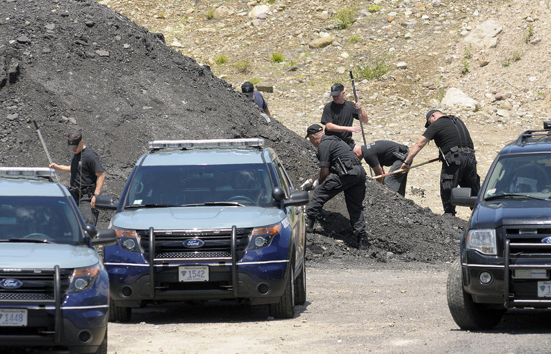Massachusetts police dig for evidence Thursday at the site where a man who was linked to New England tight end Aaron Hernandez was found dead.