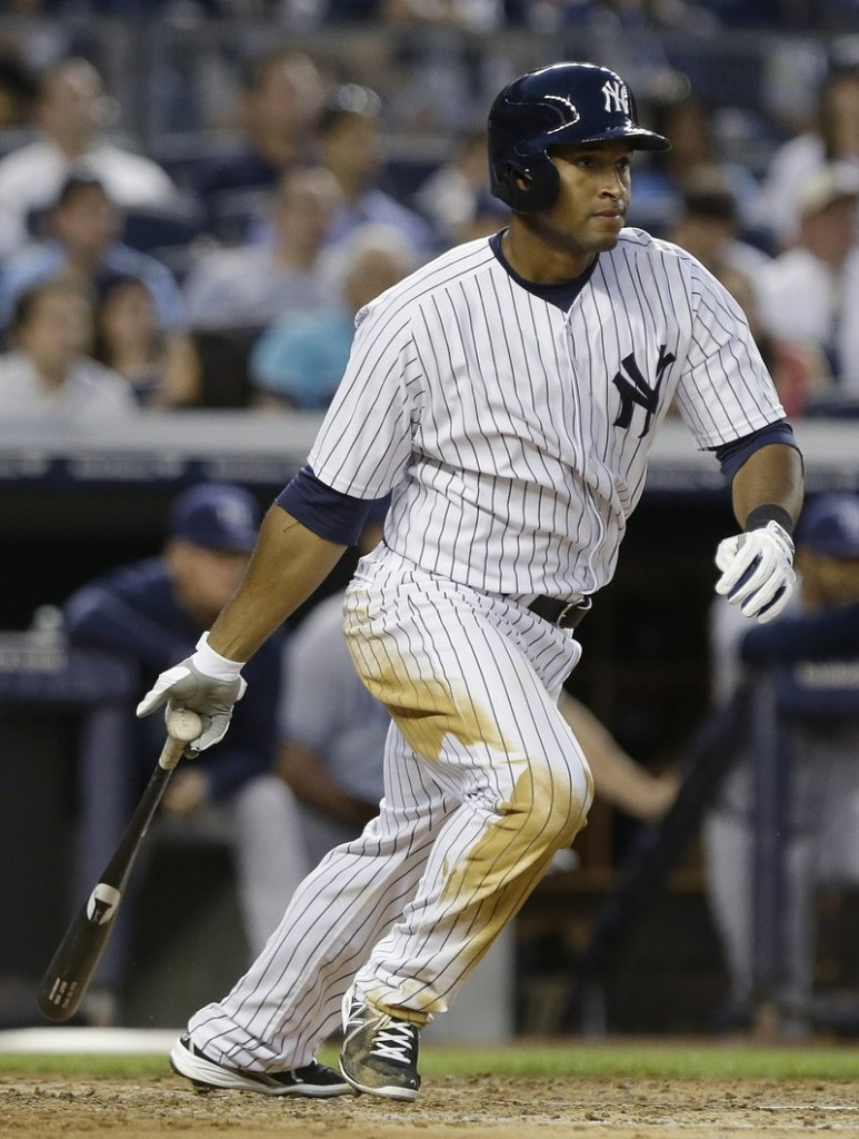 New York's Zoilo Almonte strokes a single, one of his three hits during Friday night's 6-2 victory over the Tampa Bay Rays. Almonte started in place of injured outfielder Vernon Wells.