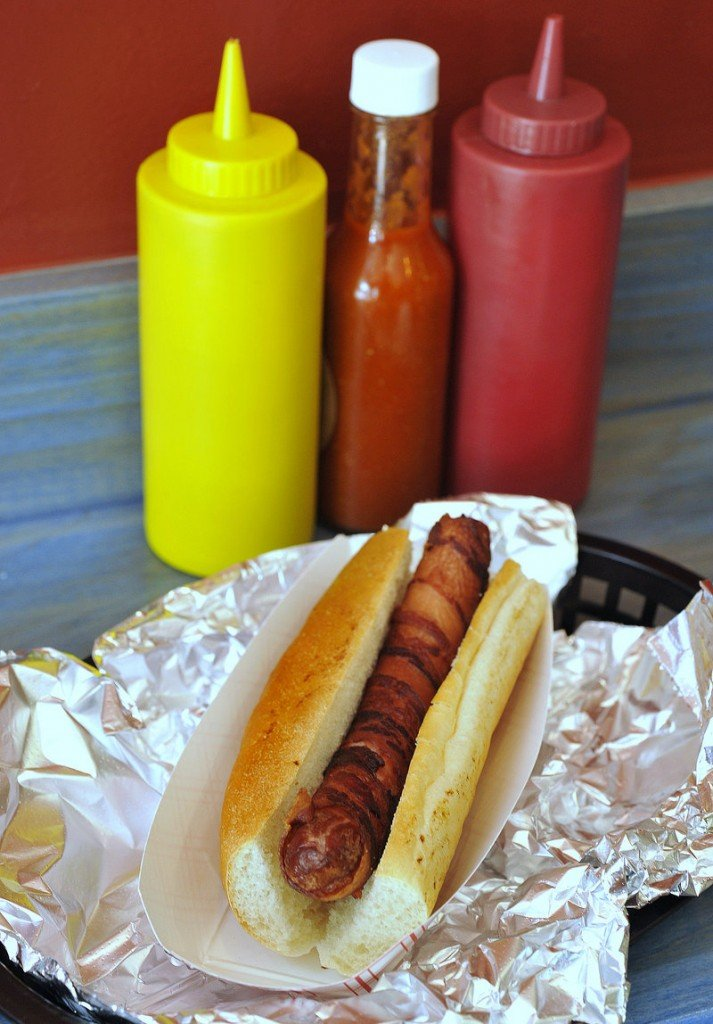 The Blue Rooster in Portland offers a variety of interesting hot dog toppers – not to mention bacon-wrapped dogs.