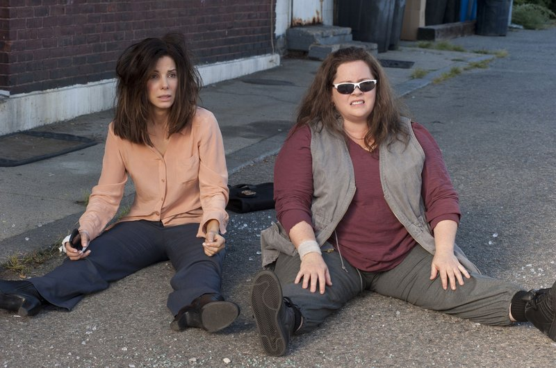 "Sandra Bullock, left, and Melissa McCarthy star as a rumpled FBI agent and a gruff Boston cop, respectively, in ""The Heat."""