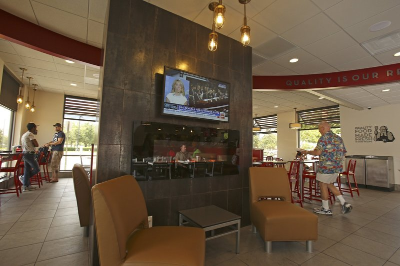 The Wendy's on Millenia Boulevard in Orlando, Fla., hopes to attract a broader customer base by adding flat-screen televisions and a fireplace to the interior of their restaurant.