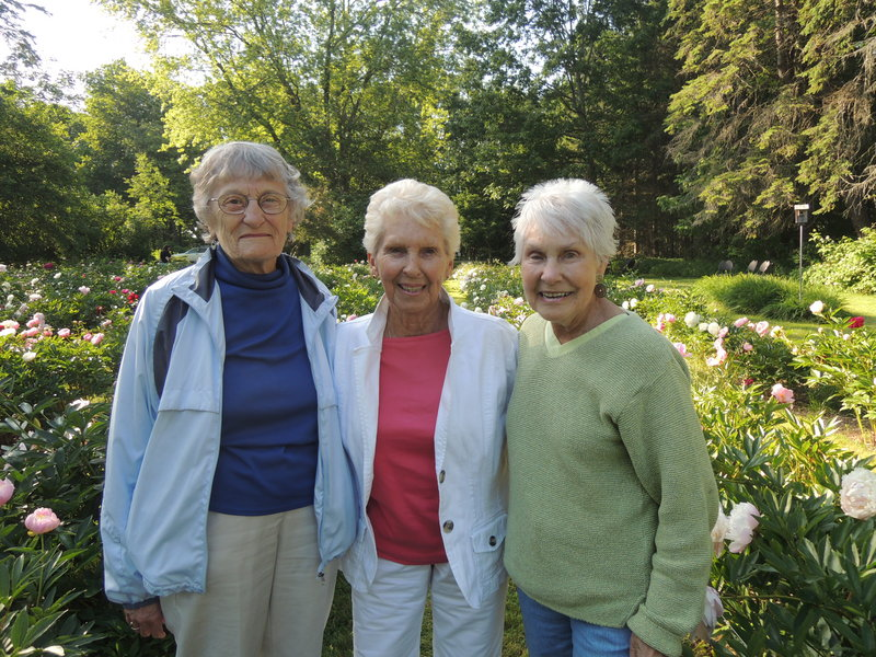 Edith McCormick, Elizabeth Johnson and Joan Roux, all of Portland, enjoy the formal peony garden at Gilsland Farm.