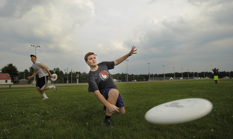 Ben Smith of Portland, soon to be a freshman at the University of Maine, throws a disc during warm-ups before a Portland Ultimate Adult Summer League game Tuesday at the Cumberland County Fairgrounds, the site of eight games on this night.