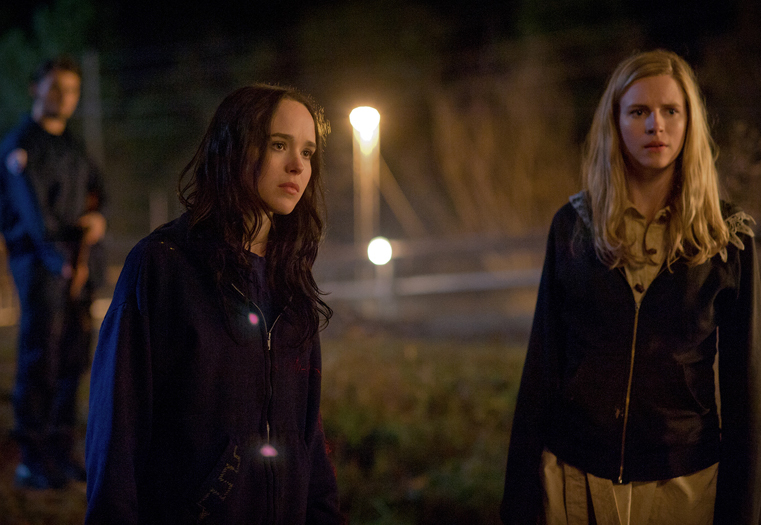 "Ellen Page, left, is Izzy, an anarchistic environmentalist, and Brit Marling is Sarah, a former federal agent chasing Izzy's group in the thriller ""The East."""