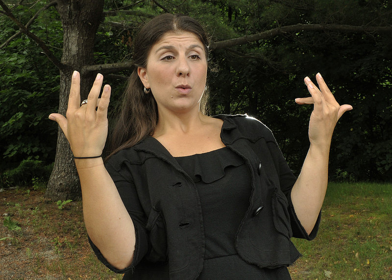 """Holly Maniatty of Falmouth demonstrates her live music signing technique to the lyrics of Wu-Tang Clan's """"Protect Ya Neck."""" Here she signs:"""
