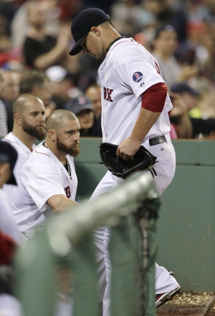 John Lester heads to the dugout after hip pain forced him off the mound during Thursday's victory over Toronto at Fenway Park.