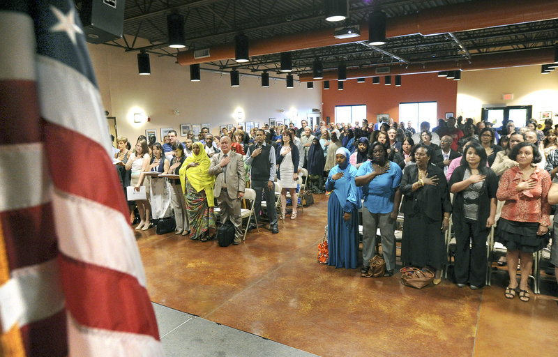 New U.S. citizens recite the Pledge of Allegiance on Friday at the Lewiston Regional Technical Center.