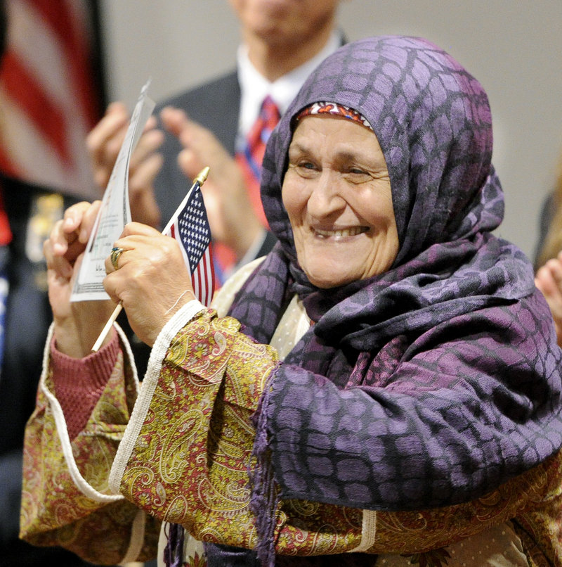 Fatima Mouifadan, from Morocco and now of Lewiston, proudly celebrates.
