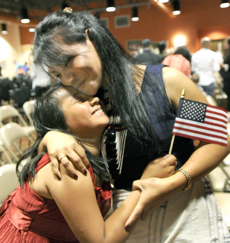 Kumari Lucas, from India and now of Topsham, is hugged by daughter Anna.