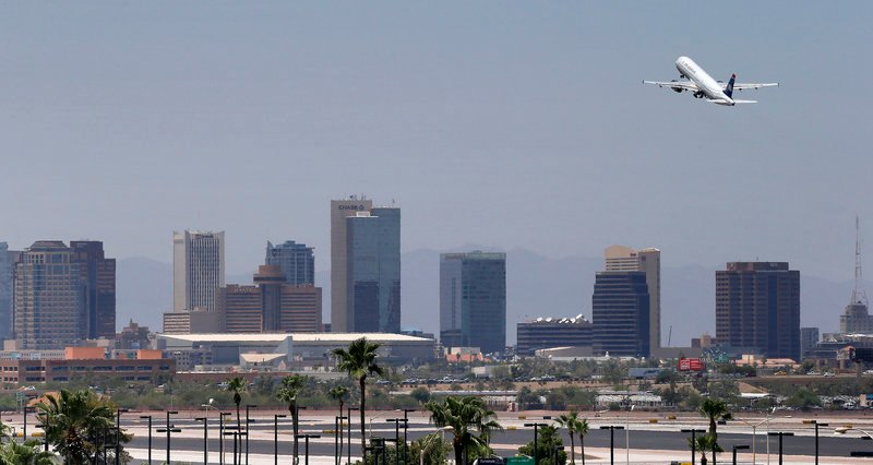 A jet takes off from Sky Harbor International Airport in Phoenix on Friday. Airlines are monitoring temperatures to make sure it's safe to fly as heat engulfs much of the Southwest. Extreme temperatures make it difficult for smaller planes to lift off.