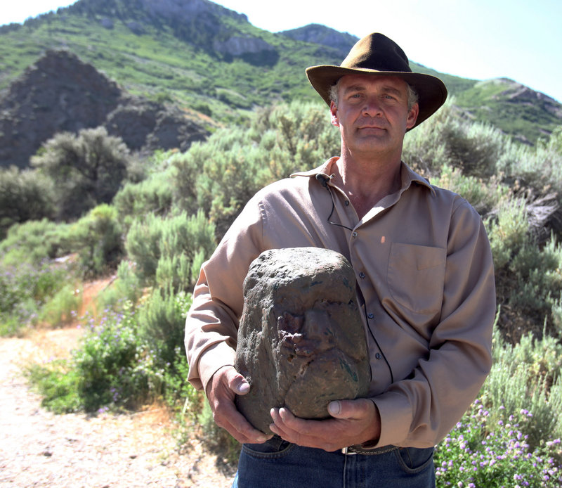 Todd May of Ogden, Utah, holds what he believes to be the fossilized head of a Bigfoot in Ogden earlier this month.