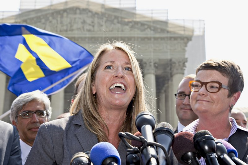 Sandy Stier, left, and Kris Perry react outside the U.S. Supreme Court Wednesday after the court cleared the way for the resumption of same-sex marriage in California.