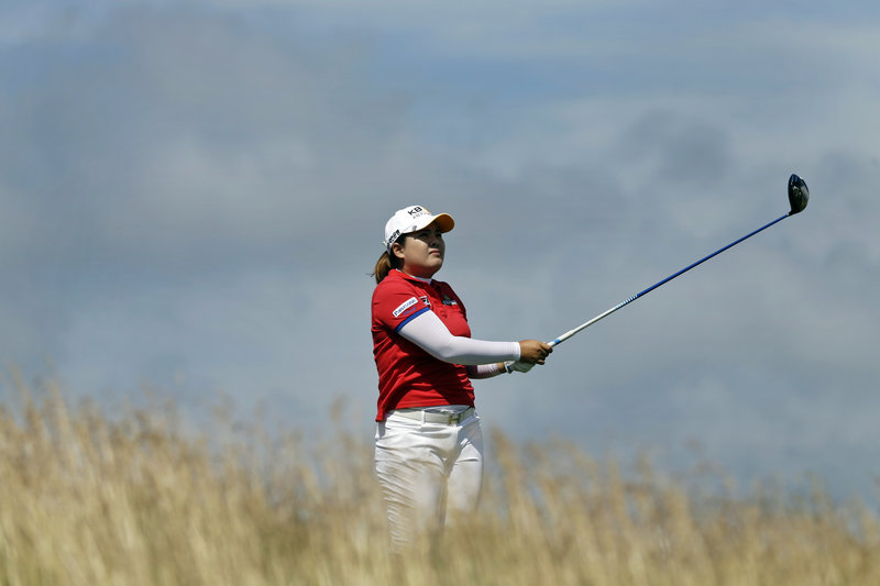 Inbee Park, watching a tee shot Saturday, is in position to become the first LPGA golfer to win the first three majors of a year in which there are four majors. She leads the U.S. Women's Open by four shots.