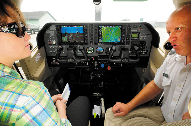 Courtney Oliver, 21, left, of Winthrop, sits in a plane cockpit Saturday at the Augusta State Airport as Civil Air Patrol Capt. Steve Vorpagel describes pluses of becoming a cadet.
