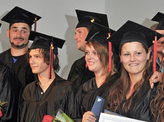 Twenty young men and women took part in a graduation ceremony from Youth Building Alternatives on June 28, 2013. The alternate education system helps dropouts get their GED certificates and more.